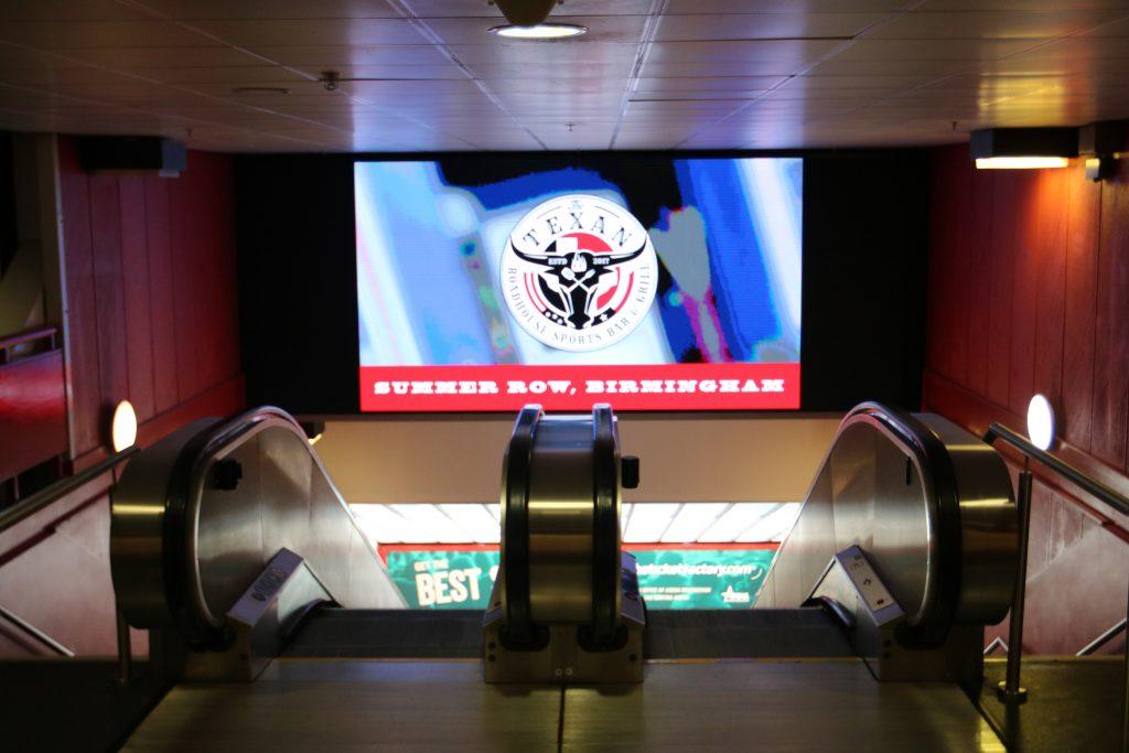 NEC escalator display